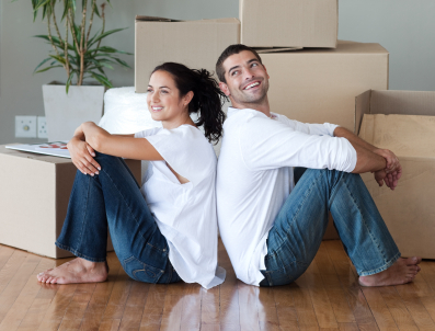 Happy Young Couple Moving House